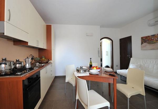 Soggiorno con angolo cottura Resort Ara Inn Torre San Giovanni