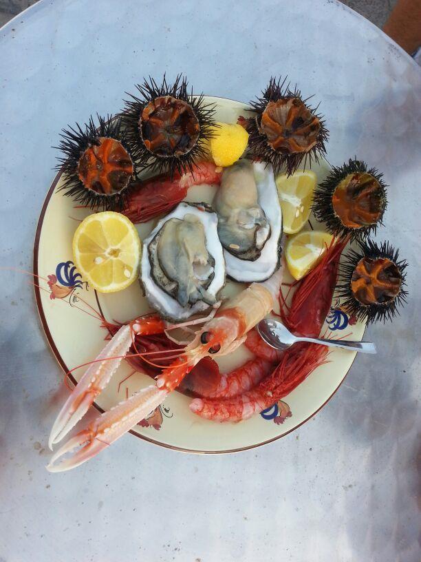 piatti di pesce preparati dai turisti dello B&B Zio Cox a Mancaversa di Taviano