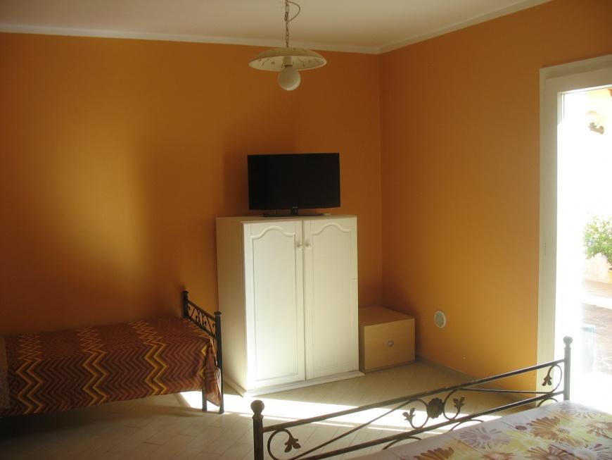 La camera 4, di buone dimensioni, adatta a coppie (anche con figlio) o piccoli gruppi