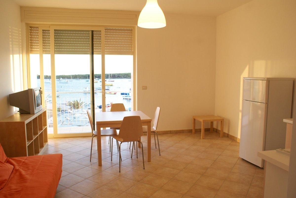 Soggiorno con angolo cottura Residence Il Porticciolo Porto Cesareo