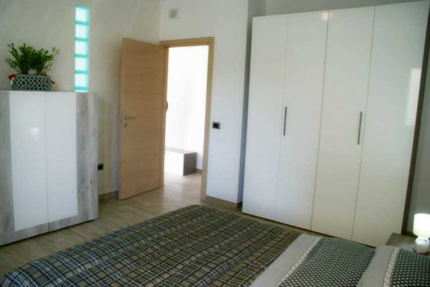 camera da letto matrimoniale appartamento scirocco Toto residence Torre Lapillo