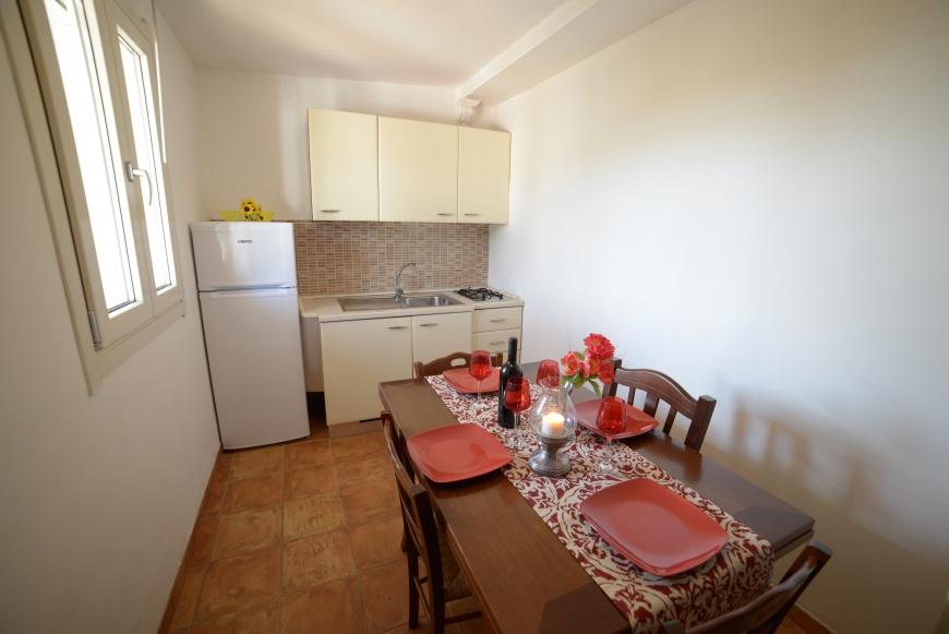 soggiorno bilocale pino residence torrelapillo.it