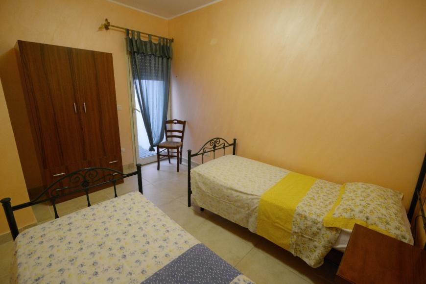 camera doppia trilocale pino residence torrelapillo.it