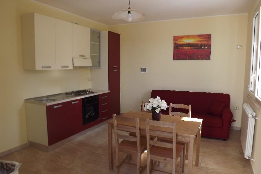 Soggiorno con angolo cottura appartamento Giallo Giurdignano, Lecce