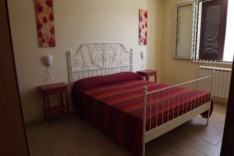 Camera da Letto appartamento giallo Giurdignano, Lecce